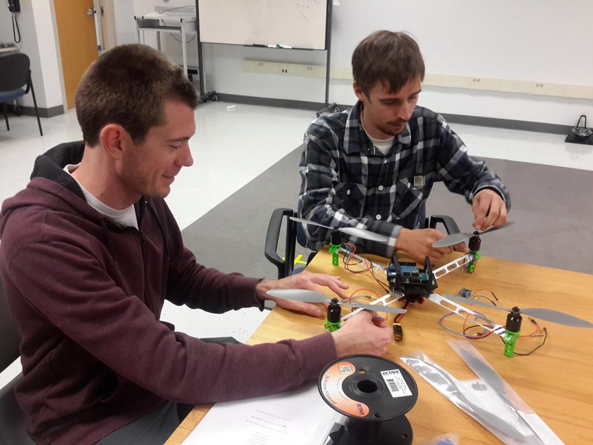 UT-Corpus Christi students Ian Gates (left) and Christoph Hintz review the characteristics of the 3-dimensional computer-aided design prototype. The experimental prototype should look and work like the 3D model.