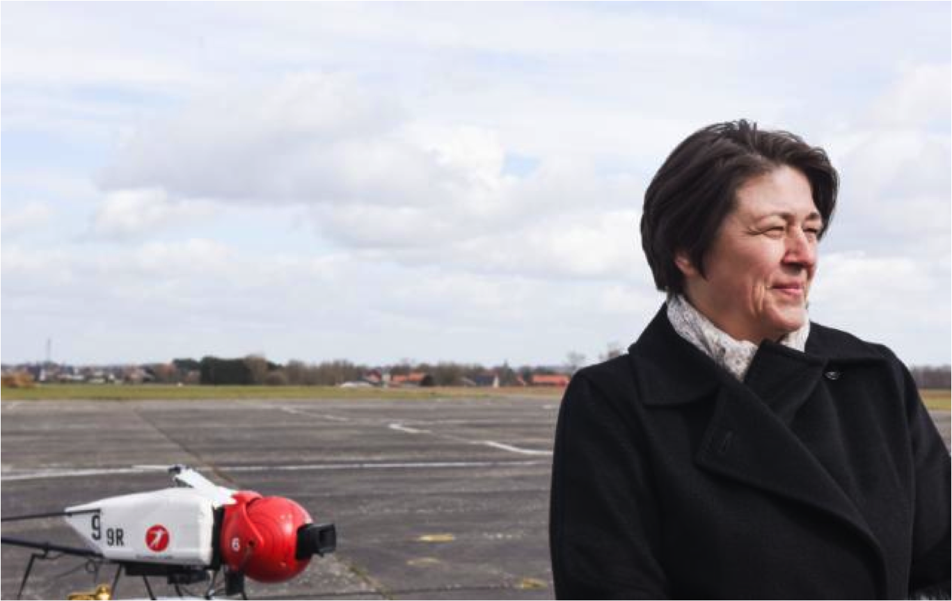 Violeta Bulc with a drone helicopter in the background.