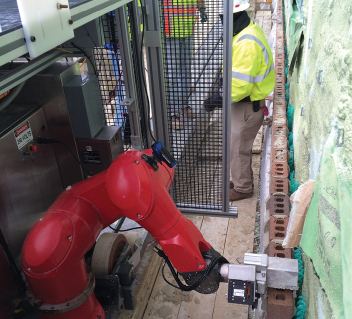Bricklaying robot at work on the construction of a barracks at Fort Lee, VA Photo courtesy of Construction Robotics
