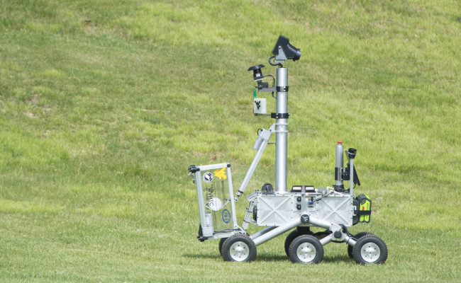 The Mountaineers team robot is seen after picking up the pre-cached sample during its attempt at the level two challenge during the 2015 Sample Return Robot Challenge, Thursday, June 11, 2015 at the Worcester Polytechnic Institute (WPI) in Worcester, Mass.  NASA