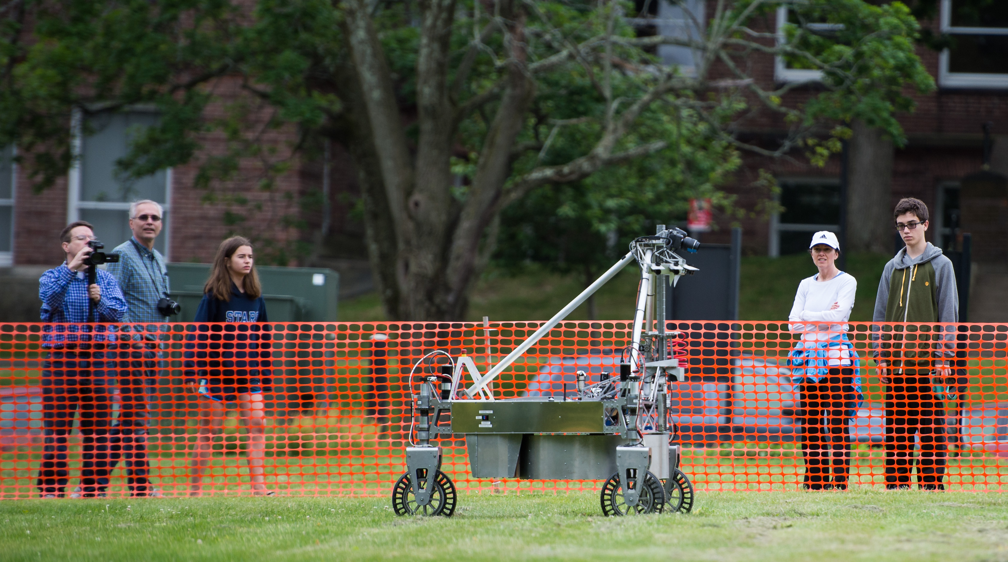 The team Survey robot is seen as it conducts a demonstration of the level two challenge during the 2014 NASA Centennial Challenges Sample Return Robot Challenge, Thursday, June 12, 2014, at the Worcester Polytechnic Institute (WPI) in Worcester, Mass.   Eighteen teams are competing for a $1.5 million NASA prize purse. Teams will be required to demonstrate autonomous robots that can locate and collect samples from a wide and varied terrain, operating without human control. The objective of this NASA-WPI Centennial Challenge is to encourage innovations in autonomous navigation and robotics technologies. Innovations stemming from the challenge may improve NASA's capability to explore a variety of destinations in space, as well as enhance the nation's robotic technology for use in industries and applications on Earth. Photo Credit: (NASA/Joel Kowsky)
