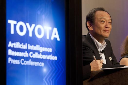 Toyota Motor Corporation Senior Managing Officer and Chief Officer of R&D Group Kiyotaka Ise speaks at a press conference announcing Toyota's collaboration with MIT and Stanford to accelerate artificial intelligence research.