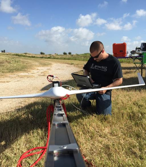 MTSI aerospace engineer, Matt Deal, prepares the Bramor for launch.