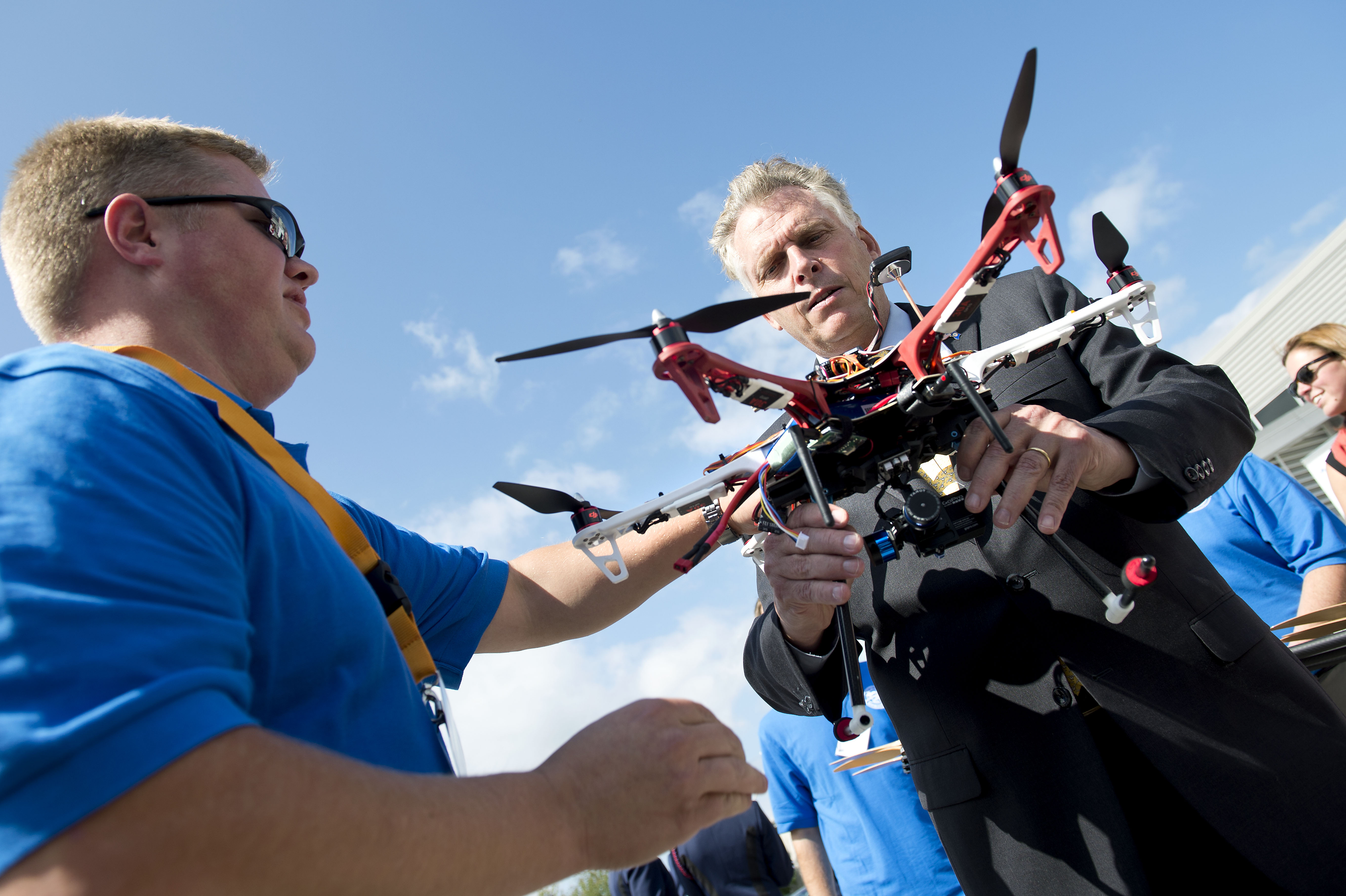 Virginia Governor Terry McAuliffe examines a drone after the demonstration flight. Mid-Atlantic Aviation Partnership