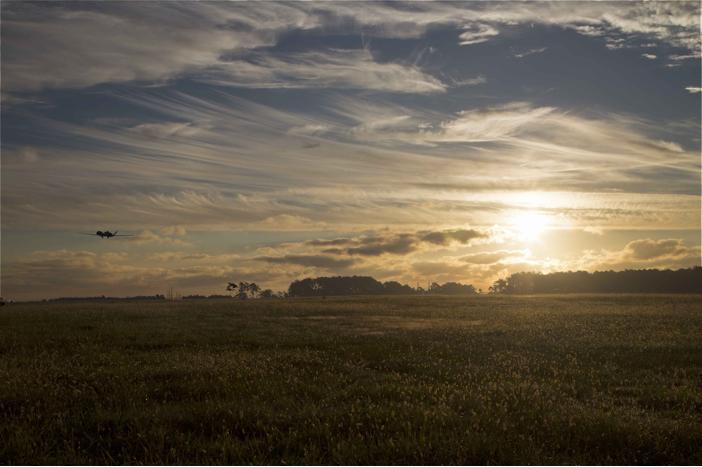 NASA's Global Hawk takes off into the sunset after mission wrap-up at NASA Wallops and heads back to NASA Armstrong.  Image Credit: NASA
