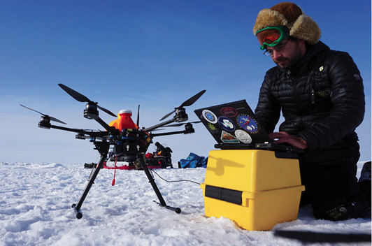 Alaska team member Eyal Saiet operating the Ptarmigan UAS on sea ice.