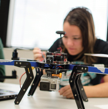 girl working on drone