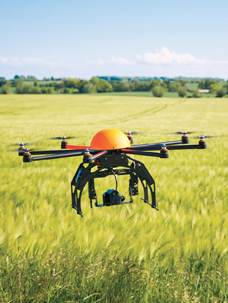 A UAS flies over a field in North Dakota.