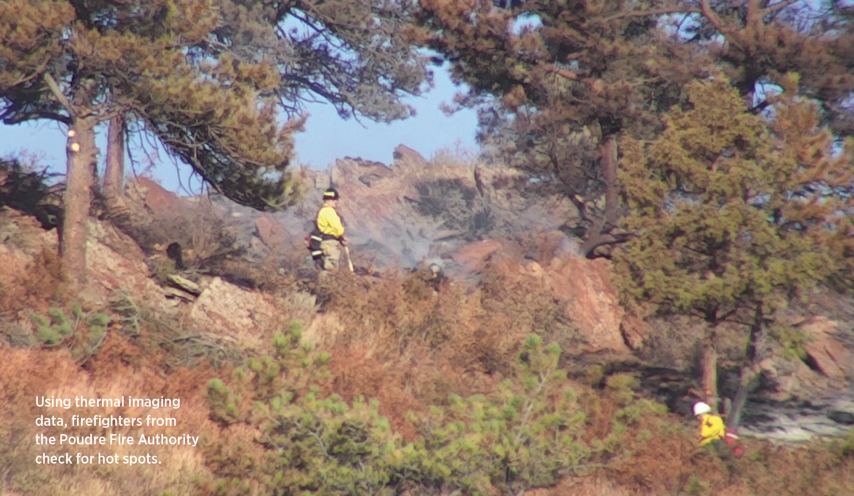 Using thermal imaging data, fi refi ghters from the Poudre Fire Authority check for hot spots.