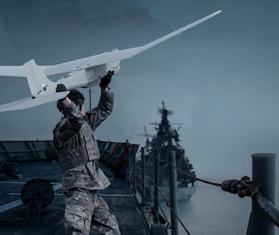 Soldier launching unmanned aircraft from ship